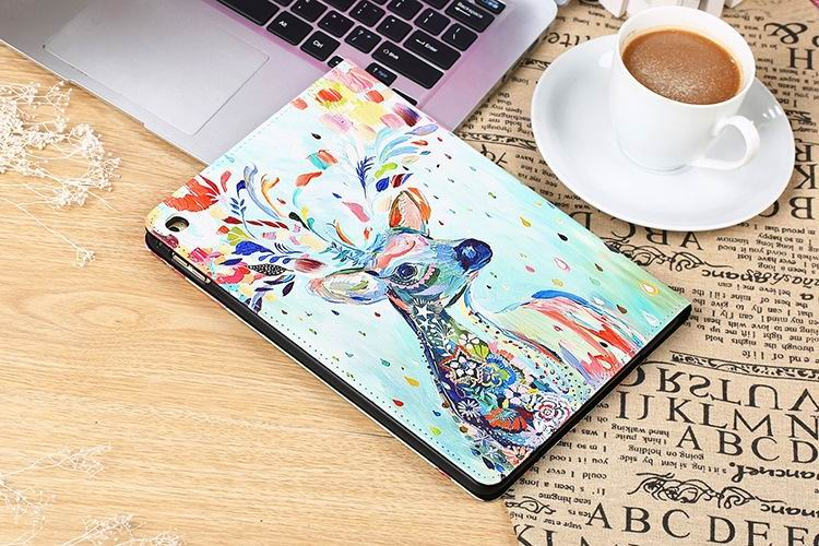 ipad pro 9 inch cute cover with a picture of a colorful deer and black inside with 2 stand and plastic body